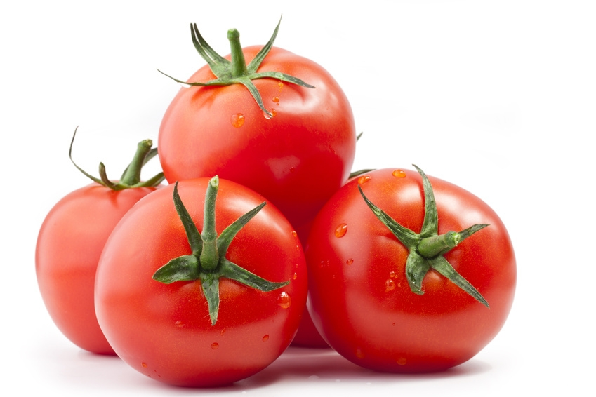 Tomatos with a light shadow isolated on white